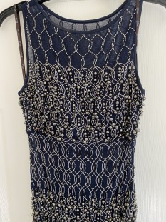 Navy beaded gown by Camille La Vie