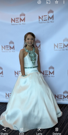 White little miss formal wear with beaded top and back.