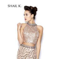 Shail K